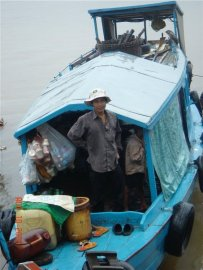 Coffee shop on Vietnamese floating village in Cambodia