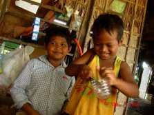 Kids at play with very big knife - Cambodia
