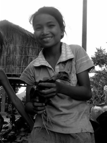Holding the chick - Cambodia