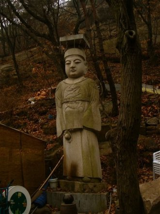 White statute in Korea.. solitary.. meditative..