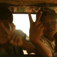 Cambodia jumping on tuk tuks in rural areas