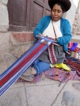 Sits on random corners and makes blankets, table runners, belts and possibly anything you could want out of yarn.  Each item under about $5.00.  How long does she need to work to feed herself?