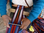 Weaving very intricate designs with multi-colored Alpaca threads.