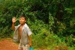 kid walking down dirt road cambodia