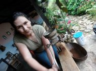 Organic farm posada owner prepping fresh ground coffee