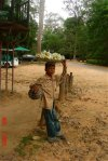 young boy selling fruit at entrance to Angkor Wat