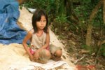 young girl on side of hill asking for handouts cambodia