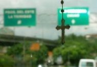 zoom on a cross in Caracas, Venezuela in taxi