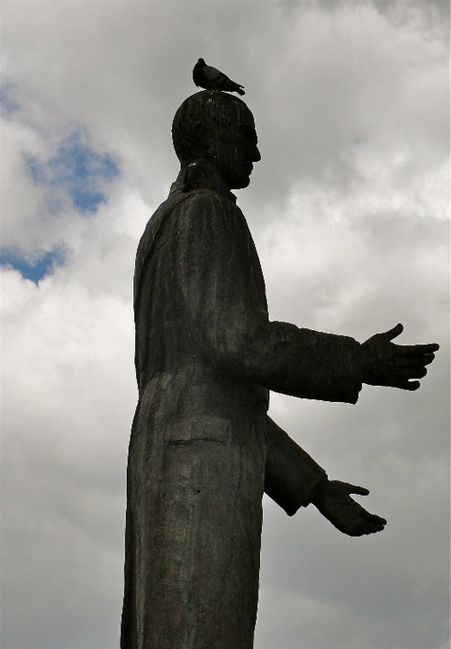 Statute in Peru with bird on head.