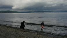 Daughters and grandbabies on Alki Beach in Seattle.. Liquid city