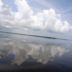 Bright clouds reflecting off of Lake Maracaibo in Catatumbo, Venezuela.