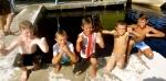 Kids swimming and flexing in the bright sun.. Catatumbo, Venezuela.
