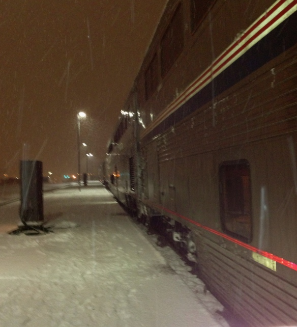 Train leaving Spokane in a blizzard.