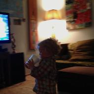 Iphone 5 photo of grandson watching football.