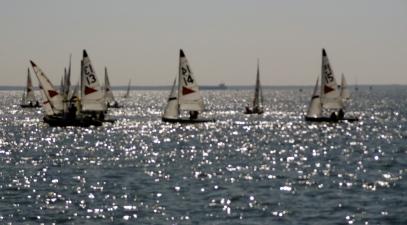 sailboats on a beautifully lit waterway
