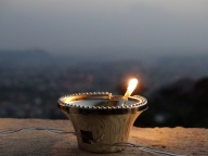 Electric candle with Kathmandu in background