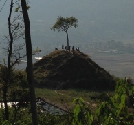 A random hill with random kids yelling random happy Nepali phrases at us.