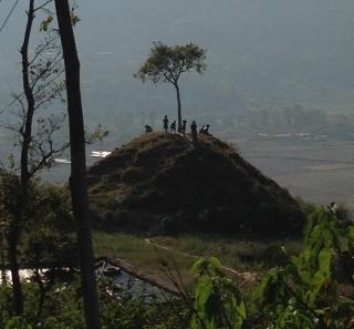 A random hill with random kids yelling random happy Nepali phrases at us.