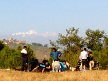 Special festivities with locals with the mountains in the background