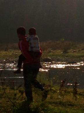 Loved this picture of man taking his child to the festival