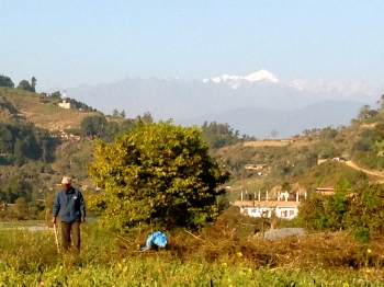 Finding our way along the river banks with the mountains in the background