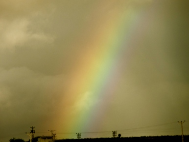 Edge of the skyline with a rainbow shooting out in Ankara Turkey