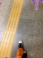 yellow lines and color coded arrows on the ground that also direct you.