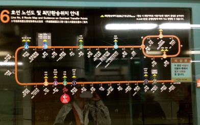 doors of the subway entrance with subway maps on them so you can judge the distance to your stop.