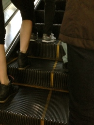 escalators with yellow lines. show you where to stand if you are standing and where to walk if you are walking